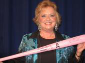 """Karen holding the pink """"cancer"""" bat in honor of her & Tom Grant's song, """"I'm Gonna Beat This Thing."""""""