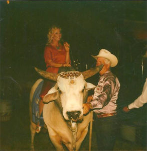 "Karen riding ""Jim Shoulder's Bull"" into the arena singing."