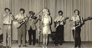 Karen performing with the Roy Acuff USO Group (l to r: Onie Wheeler, A.J. Nelson, Roy Acuff, Karen, Leo Bittner & Charlie Collins)